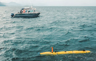 University of Victoria's AUV surfaces on the waters of Juan Perez Sound. Photo courtesy of the University of Victoria.