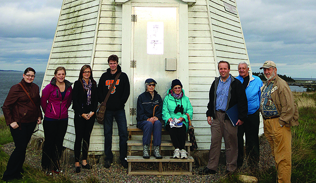 CBU students and local residents pose in front of the lighthouse with Dr. Urbaniak (third from right).