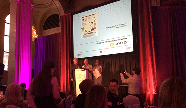 UA Editor Leo Charbonneau accepts the gold award for Best Cover. Photo by Natalie Samson.