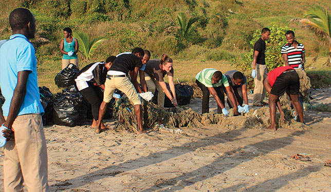 University of Victoria geography major and Queen Elizabeth Scholar Trilby Buck (brown shirt, centre) did a work term at the African Institute for Mathematical Sciences in Ghana from September to December 2015 – and also found time to help with local beach clean-up efforts. Photo by the University of Victoria.