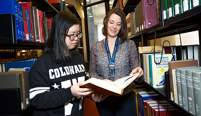 Student engagement librarian Heather Buchansky helps a student. Photo courtesy of the University of Toronto.