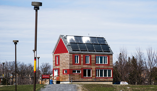 It might look like an  ordinary farmhouse, but the CHEeR house at Carleton University is an endlessly adaptable experiment in unconventional energy-saving concepts and technology for the single-family home. Photo by Luther Caverly.