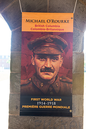 Michael O'Rourke was awarded the Victoria Cross for his actions as a stretcher-bearer at the Battle of Hill 70 during the First World War. His portrait appears on Toll of War banners in B.C. Portrait by Sharif Tarabay.