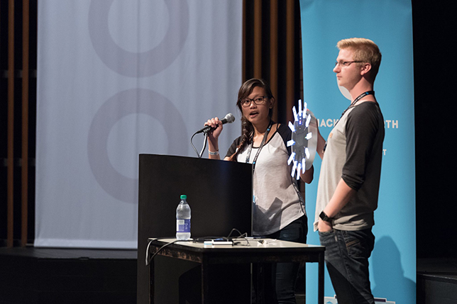 Michelle Mabuyo and Brad Moon from the University of Alberta present their Weasley Clock. Photo by JK Liu.