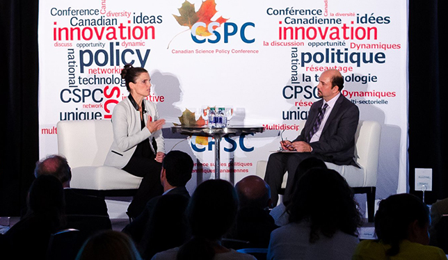 Science Minister Kirsty Duncan speaks with CSPC president Mehrdad Hariri. Photo courtesy of the Canadian Science Policy Conference.